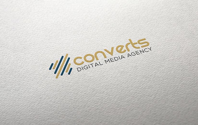 Das CONVERTS Logo auf Papier, Digital Media Agency für Webdesign, Fotografie und SEO